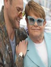 Elton John spat on the dress code at the Cannes movie show - photos